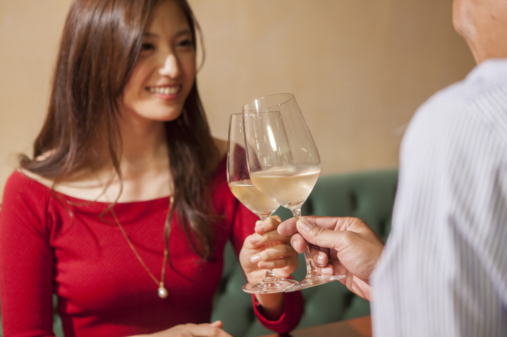 Men and women who have a toast with white wine