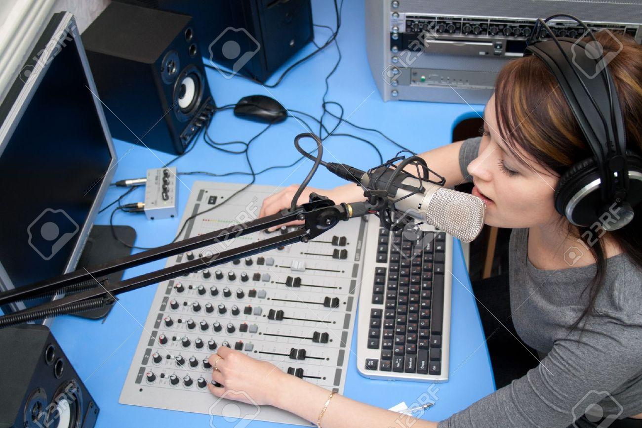 10667511-A-radio-DJ-announces-news-in-a-studio-Stock-Photo